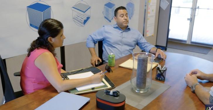 franchisee sitting at desk